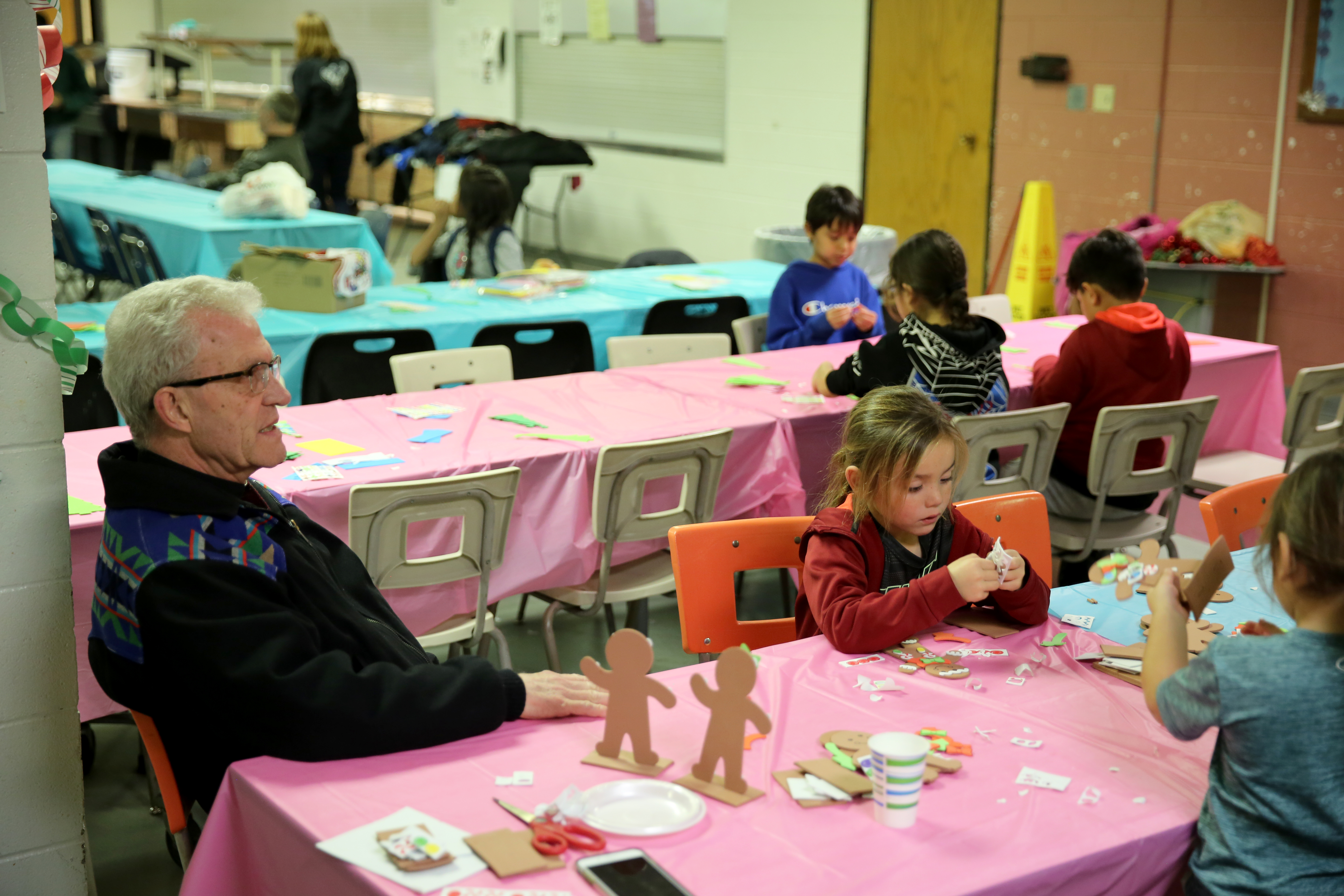 Fr. Klink and students on craft night