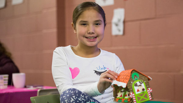 student building a gingerbread house